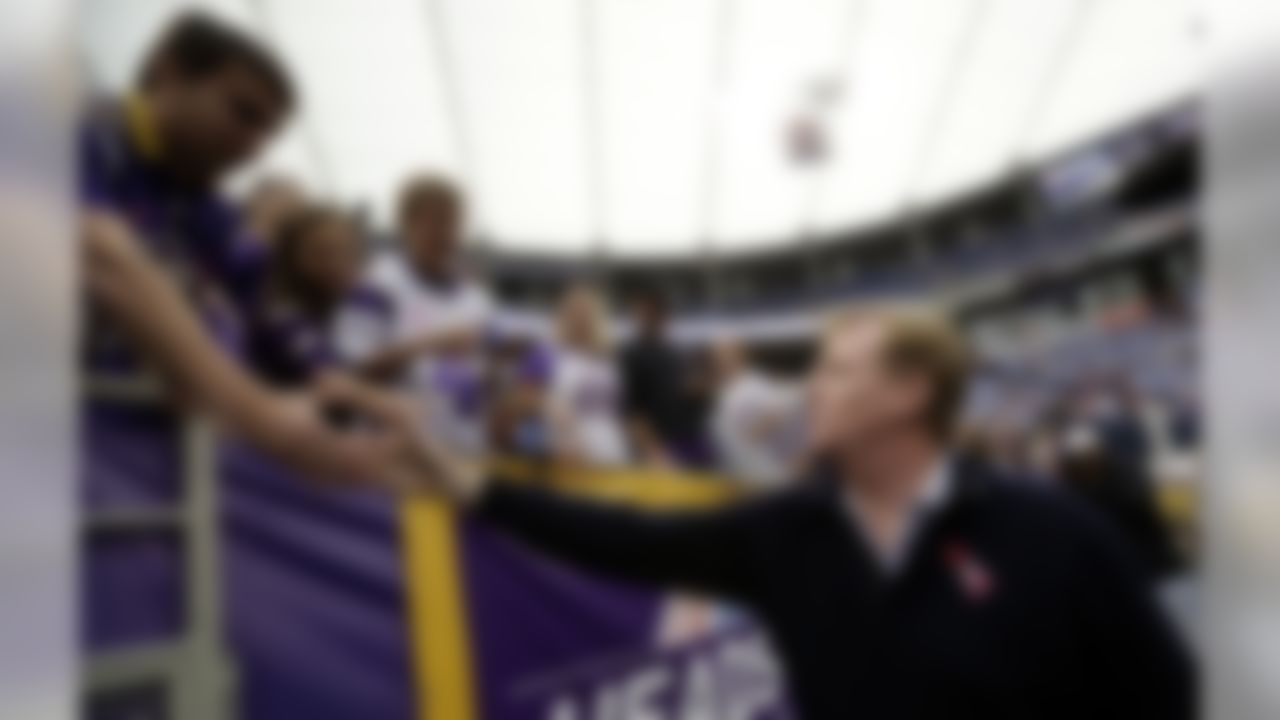 National Football League Commissioner Roger Goodell, right, greets fans before an NFL game between the Minnesota Vikings and the Tennessee Titans, Sunday, Oct. 7, 2012, in Minneapolis. (AP Photo/Charlie Neibergall)