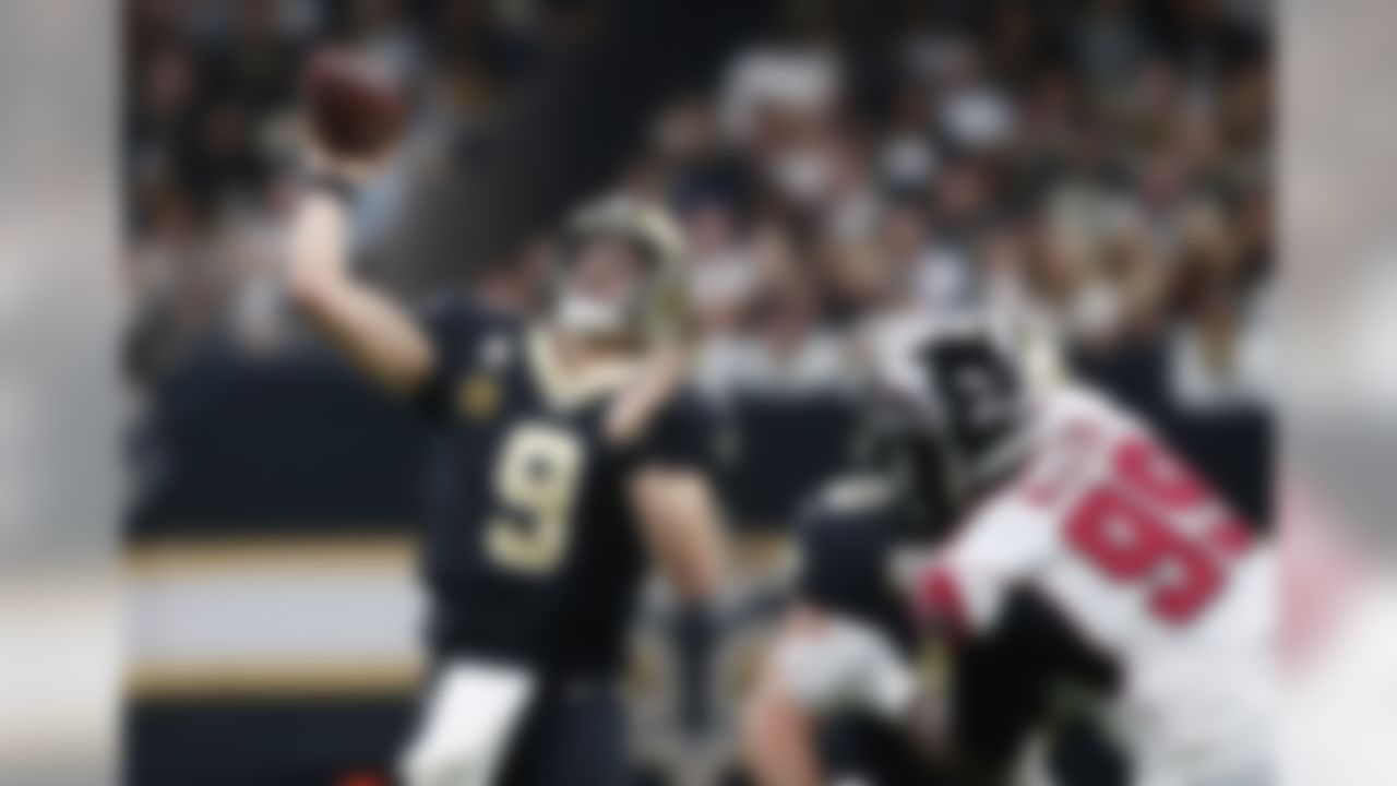 New Orleans Saints quarterback Drew Brees (9) throws a touchdown pass on their opening drive in the first half of an NFL football game against the Atlanta Falcons in New Orleans, Thursday, Nov. 22, 2018. (AP Photo/Gerald Herbert)