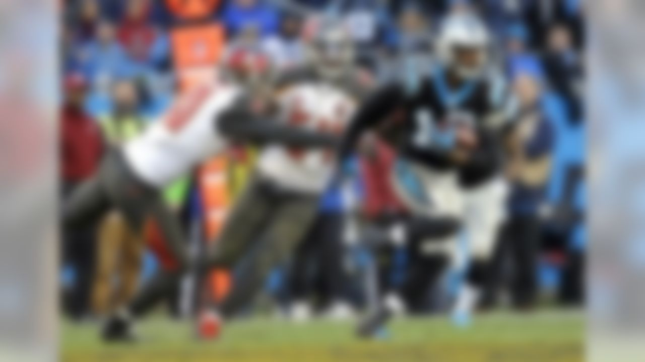 Carolina Panthers wide receiver Corey Brown (10) runs past Tampa Bay Buccaneers free safety Bradley McDougald (30) and Lavonte David (54) in the first half of an NFL football game in Charlotte, N.C., Sunday, Jan. 3, 2016. (AP Photo/Bob Leverone)