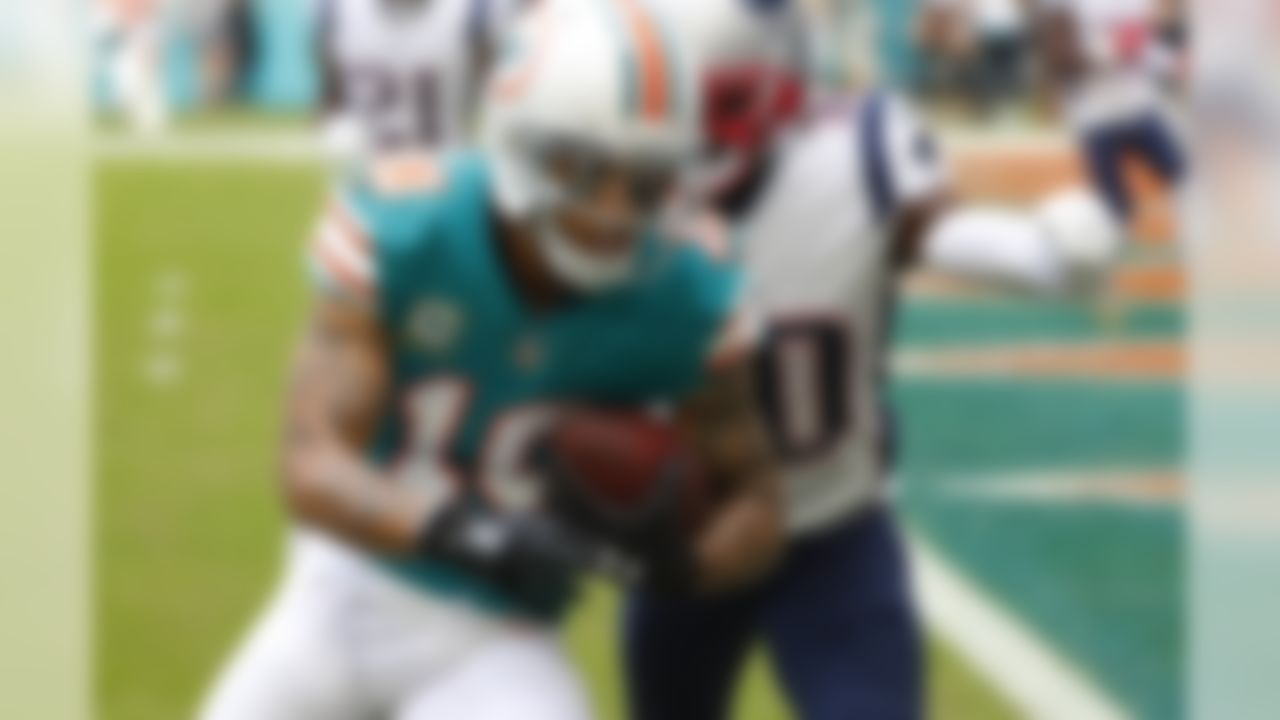 Miami Dolphins wide receiver Kenny Stills (10) runs toward a touchdown ahead of a tackle by New England Patriots cornerback Jason McCourty (30), during the first half of an NFL football game, Sunday, Dec. 9, 2018, in Miami Gardens, Fla. (AP Photo/Wilfredo Lee)
