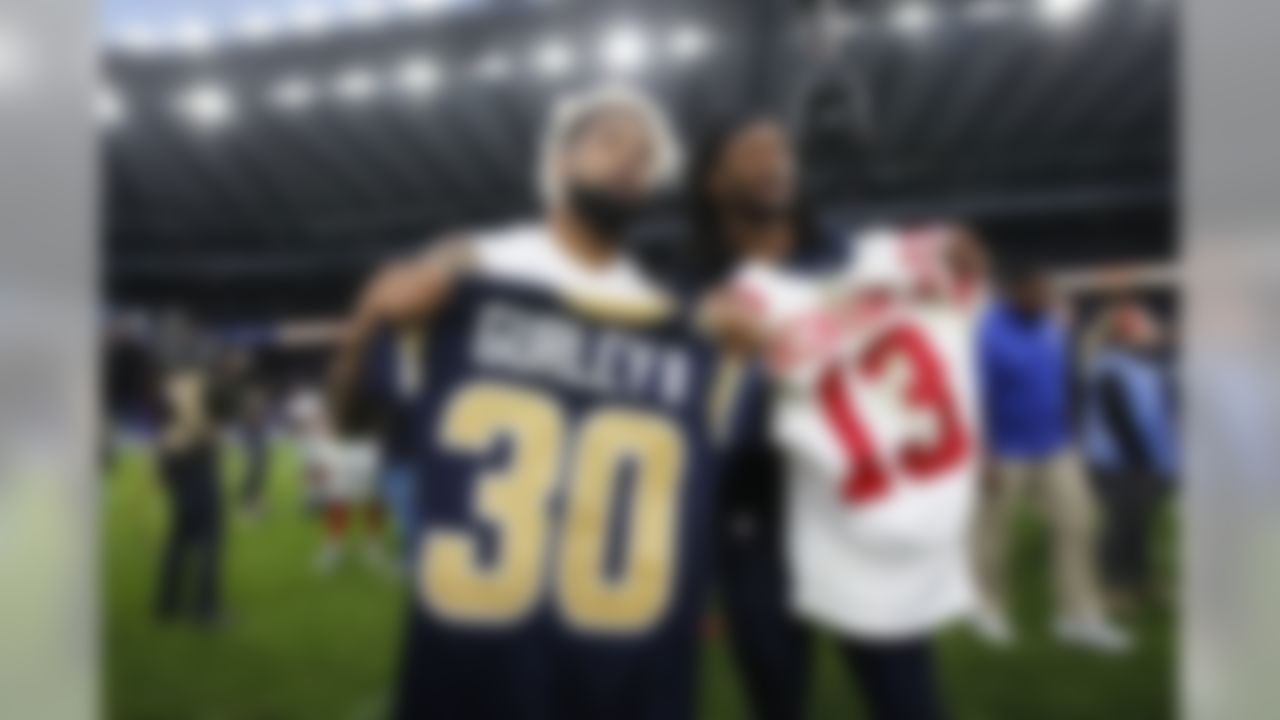 New York Giants wide receiver Odell Beckham (left) and Los Angeles Rams running back Todd Gurley pose for photo after swapping jerseys following an NFL football game at Twickenham Stadium in London, Sunday Oct. 23, 2016. Giants won 17-10. (Ben Liebenberg/NFL)