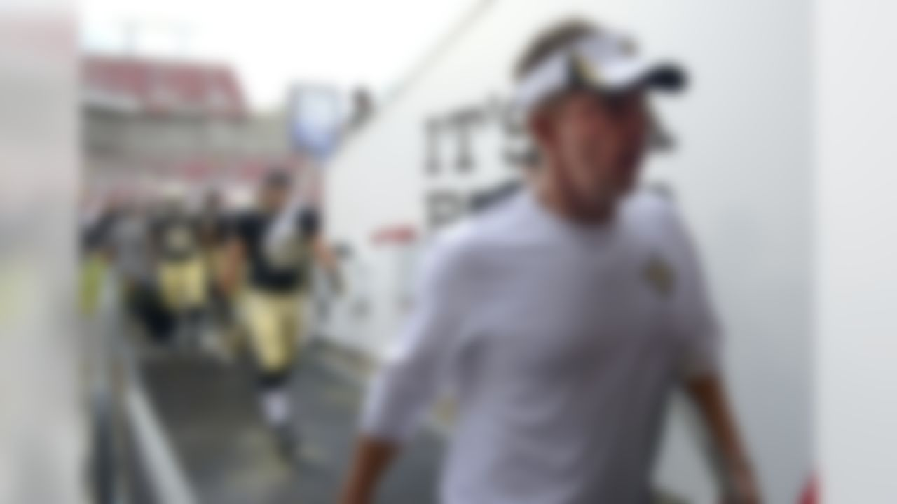 New Orleans Saints head coach Sean Payton, right, leaves the field after lightning forced a weather delay during the first half of an NFL football game against the Tampa Bay Buccaneers in Tampa, Fla., Sunday, Sept. 15, 2013. (AP Photo/Phelan M. Ebenhack)