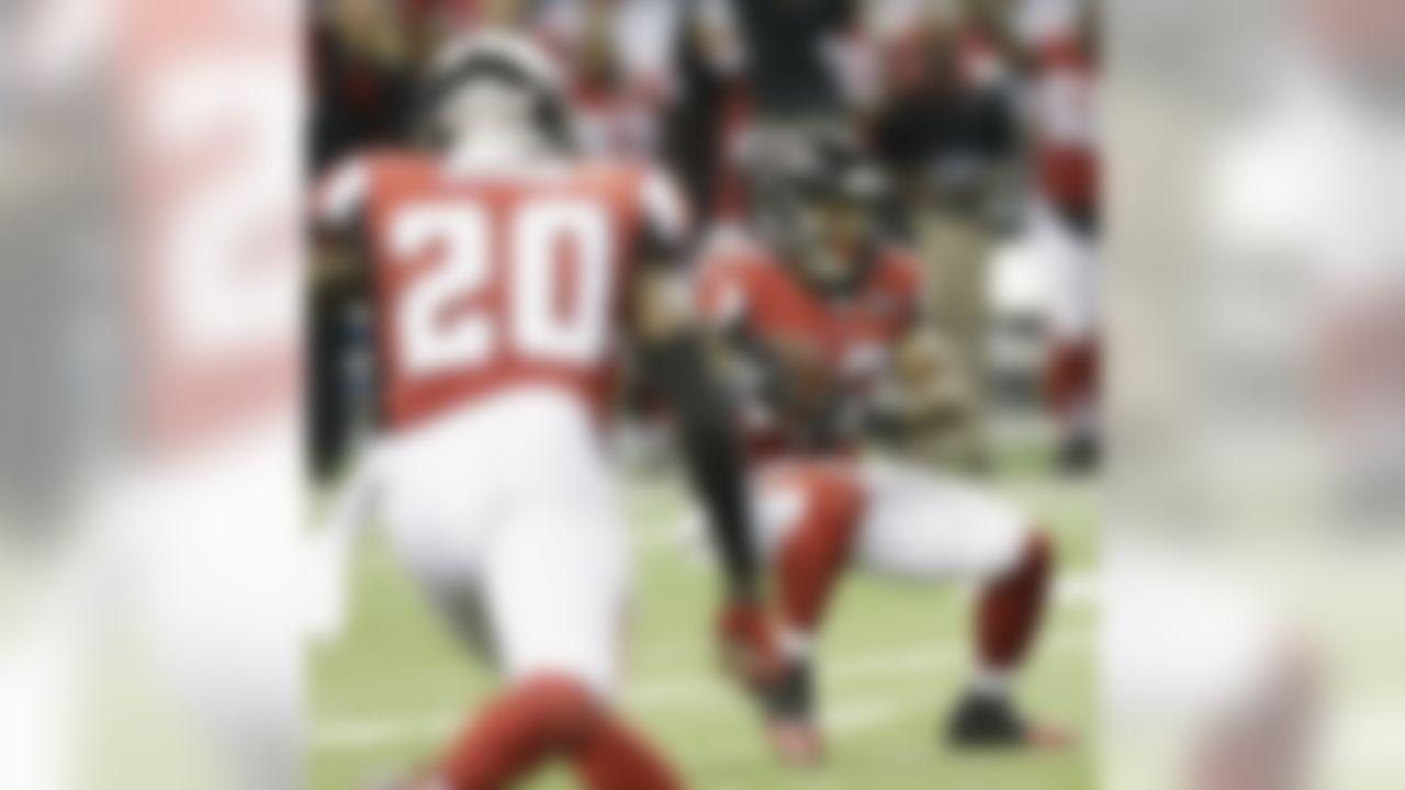 Atlanta Falcons cornerback Ricardo Allen (37) intercepts a ball intended for Philadelphia Eagles wide receiver Jordan Matthews (81) during the second half of an NFL football game, Monday, Sept. 14, 2015, in Atlanta. The Atlanta Falcons won 26-24. (AP Photo/Brynn Anderson)