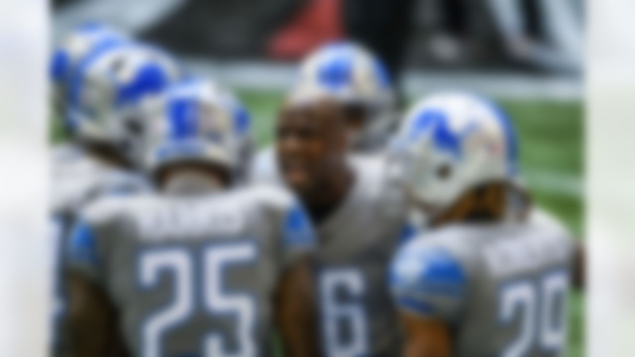 Detroit Lions running back Adrian Peterson (28) speaks to teammates before a game against the Atlanta Falcons.