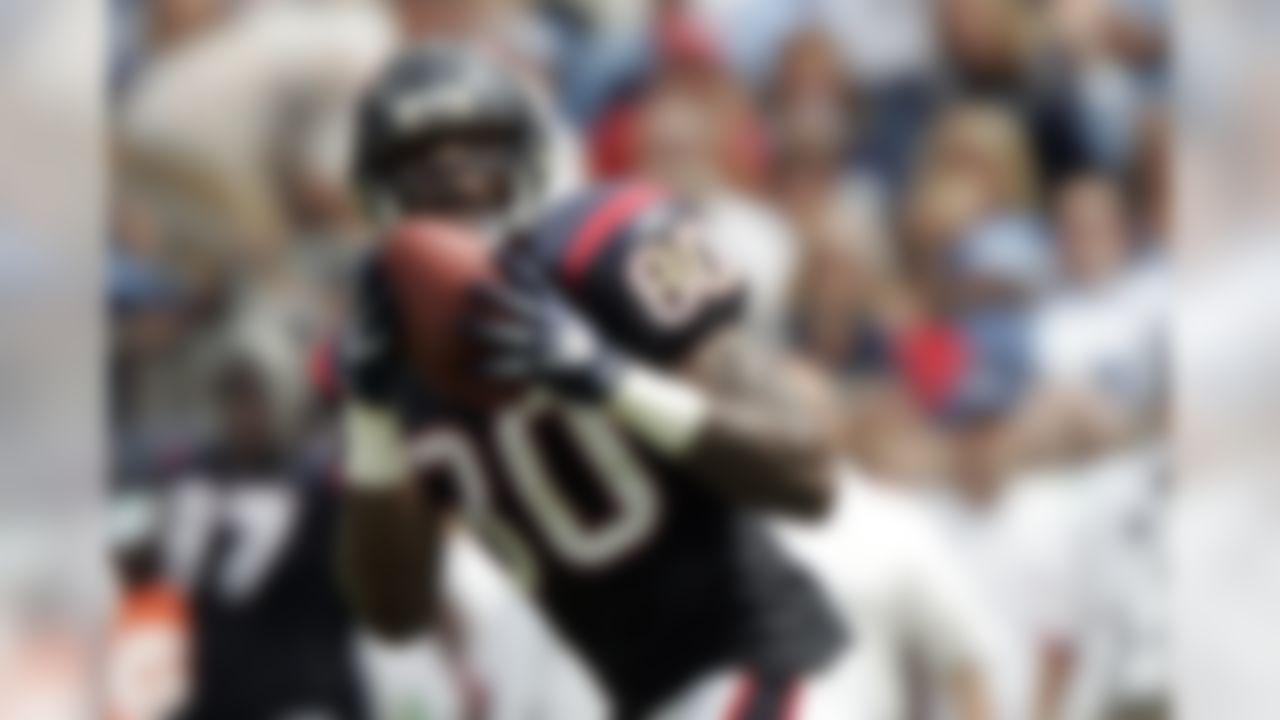 Houston Texans wide receiver Andre Johnson catches 72-yard touchdown pass against the Tennessee Titans in the second quarter of an NFL football game in Nashville, Tenn., Sunday, Sept. 20, 2009. (AP Photo/Wade Payne)