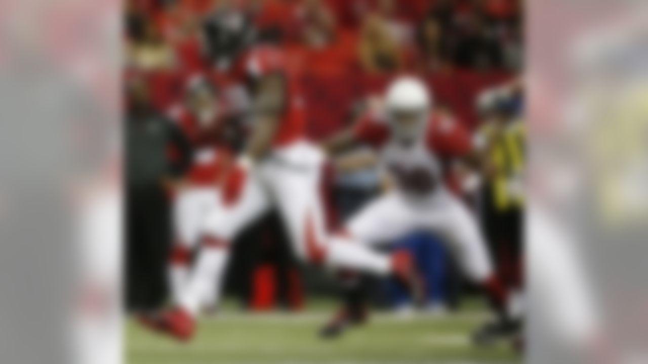 Atlanta Falcons running back Steven Jackson (39) runs against Arizona Cardinals strong safety Deone Bucannon (36) during the first half of an NFL football game, Sunday, Nov. 30, 2014, in Atlanta. (AP Photo/Brynn Anderson )
