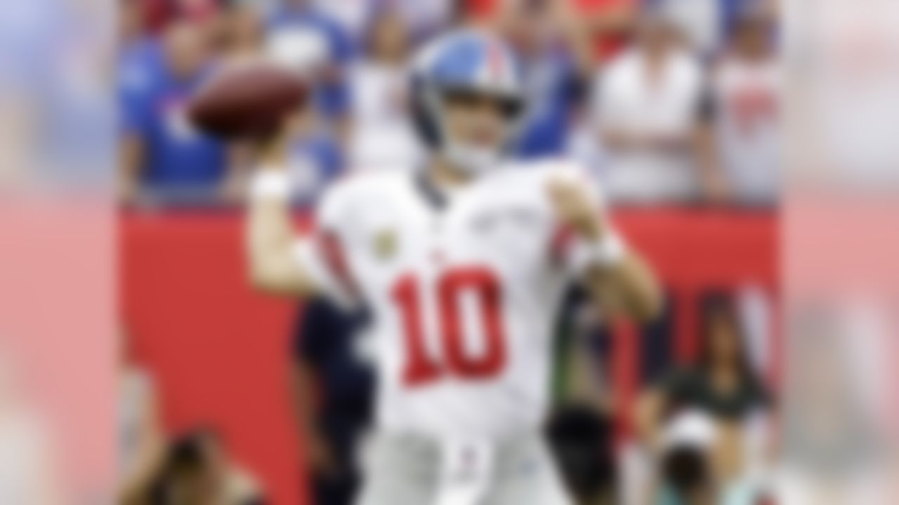 New York Giants quarterback Eli Manning (10) throws an interception on the first play from scrimmage during the first quarter of an NFL football game against the Tampa Bay Buccaneers Sunday, Nov. 8, 2015, in Tampa, Fla. (AP Photo/Chris O'Meara)