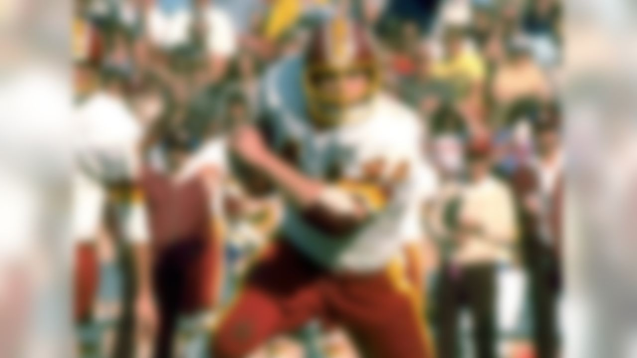 Riggins rushed for 1,000-plus yards in both 1978 and 1979, but he decided to sit out the entire 1980 season. He didn't return until 1981, after new Redskins coach Joe Gibbs convinced him to make a comeback to the gridiron. Upon his return, Riggins played in just 23 combined games and failed to rush for more than 750 yards in the following two seasons. In fact, he wouldn't reach the 1,000-yard rushing mark again until the 1983 campaign.  (AP Photo/NFL Photos)