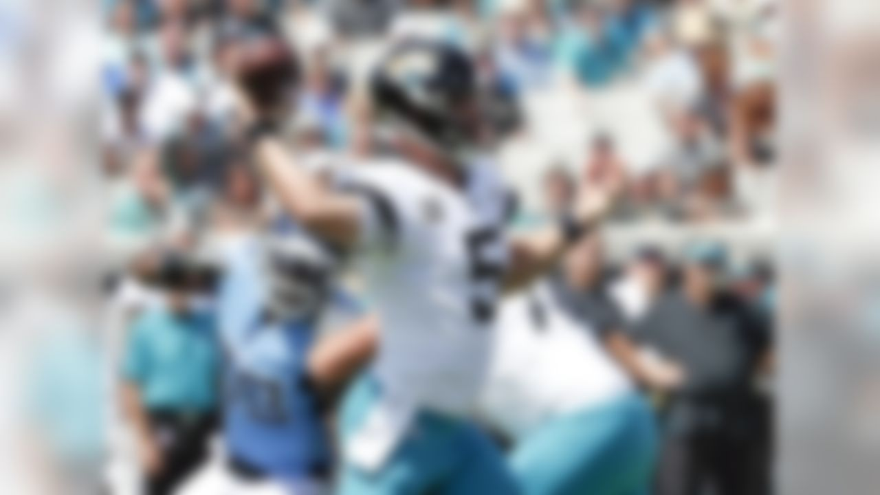 Jacksonville Jaguars quarterback Blake Bortles (5) throws a pass as he is pressured by Tennessee Titans linebacker Brian Orakpo, left, during the first half of an NFL football game, Sunday, Sept. 23, 2018, in Jacksonville, Fla. (AP Photo/John Raoux)