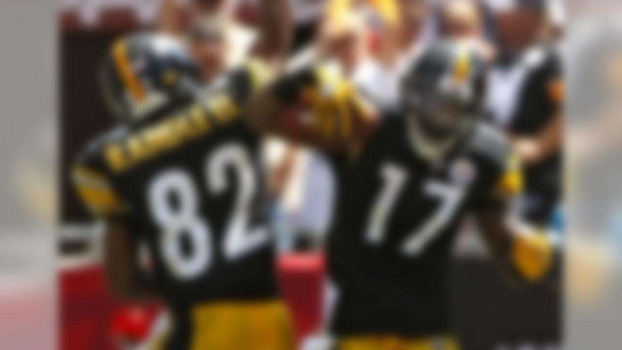 Pittsburgh Steelers wide receiver Mike Wallace (17) celebrates with teammate Antwaan Randle El after catching a first-quarter touchdown pass against the Tampa Bay Buccaneers during an NFL football game Sunday, Sept. 26, 2010, in Tampa, Fla. (AP Photo/Brian Blanco)