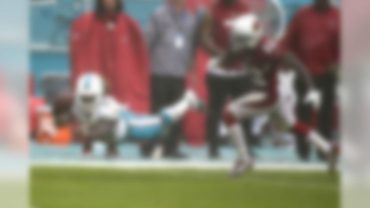 Miami Dolphins running back Jay Ajayi (23) attempts to make a catch as Arizona Cardinals strong safety Tony Jefferson (22) is late with the tackle, during heavy rain in the first half of an NFL football game, Sunday, Dec. 11, 2016, in Miami Gardens, Fla. (AP Photo/Wilfredo Lee)