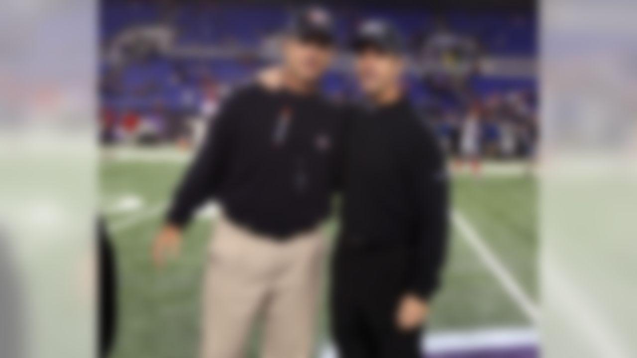 San Francisco 49ers head coach Jim Harbaugh and Baltimore Ravens head coach John Harbaugh prior to an NFL football game at M&T Bank Stadium in Baltimore, Thursday, Nov. 24, 2011. (Ben Liebenberg/NFL)