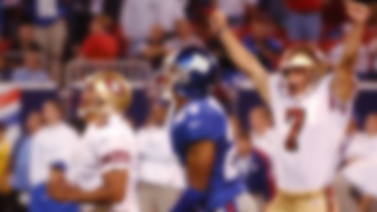San Francisco 49ers kicker Jose Cortez, left, and holder Jason Baker react after Cortez kicked a last second field goal to give the 49ers a 16-13 win over the New York Giants Thursday, Sept. 5, 2002 in East Rutherford, N.J. Giants cornerback William Peterson watches.
