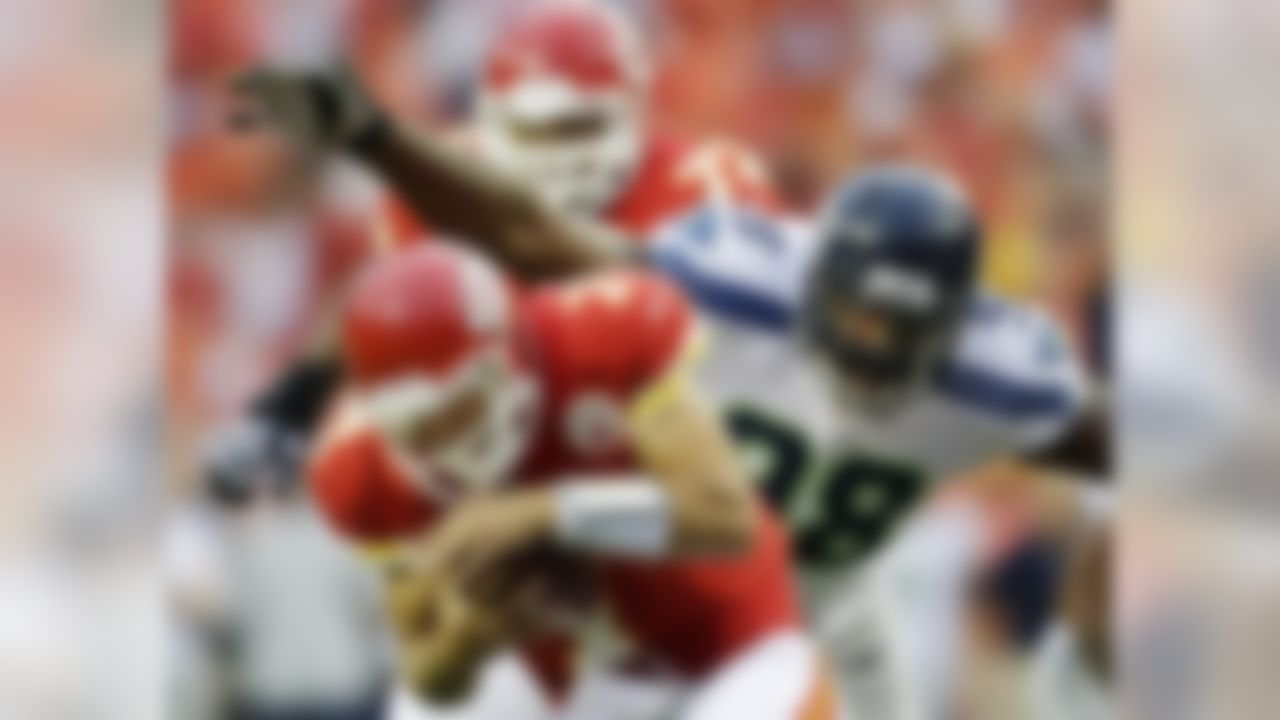 Kansas City Chiefs quarterback Matt Cassel (7) is tackled by Seattle Seahawks defensive end Greg Scruggs (98) during the first half of an NFL preseason football game in Kansas City, Mo., Friday, Aug. 24, 2012. (AP Photo/Charlie Riedel)