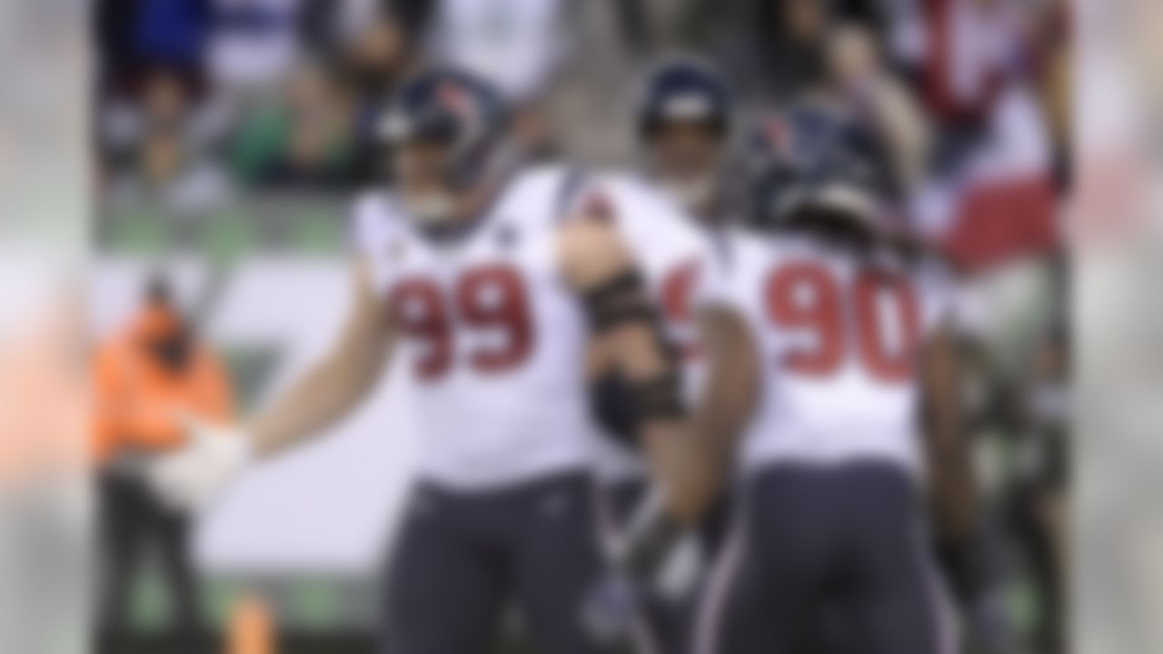 Houston Texans defensive end J.J. Watt (99) celebrates with teammates after sacking New York Jets quarterback Sam Darnold, not pictured, during the first half of an NFL football game, Saturday, Dec. 15, 2018, in East Rutherford, N.J. (AP Photo/Bill Kostroun)