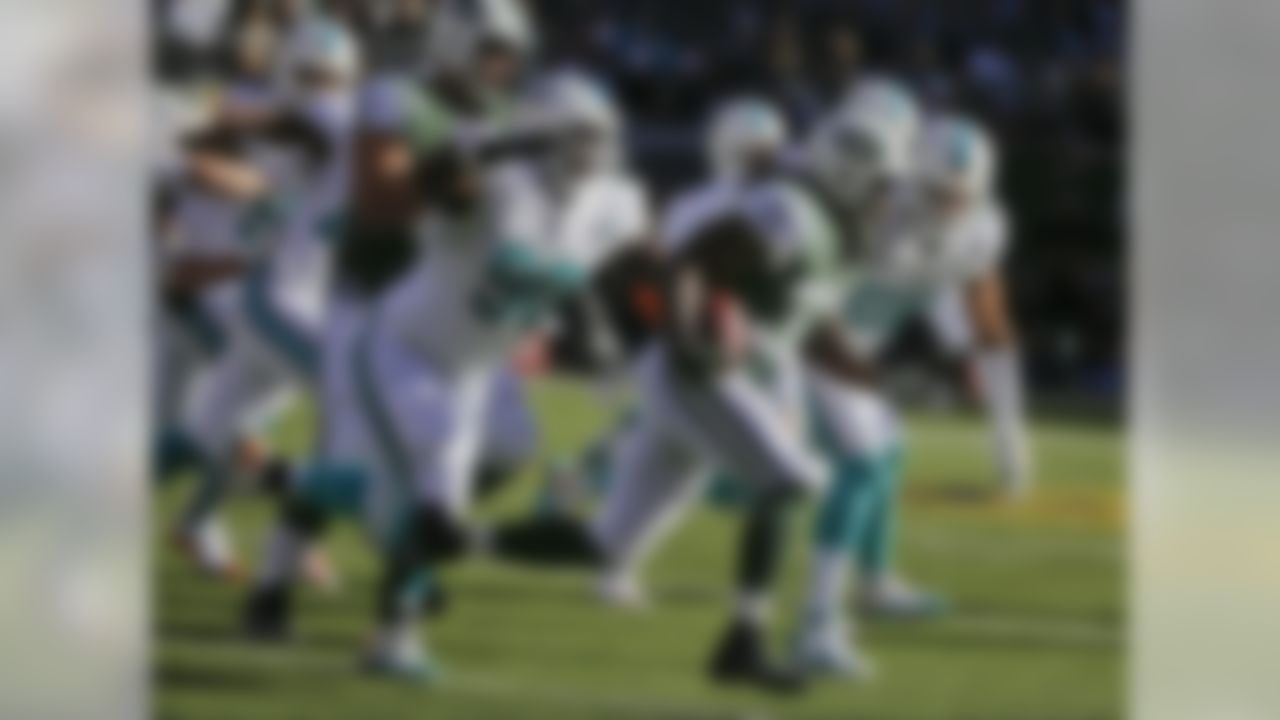 New York Jets running back Chris Ivory (33) rushes past Miami Dolphins' Earl Mitchell (90) during the first half of an NFL football game Sunday, Nov. 29, 2015, in East Rutherford, N.J. (AP Photo/Julie Jacobson)