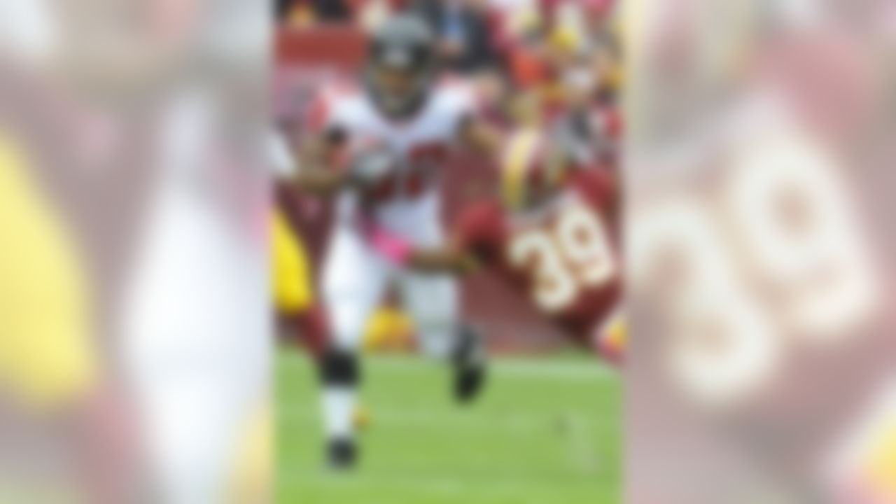 Atlanta Falcons running back Jacquizz Rodgers pushes Washington Redskins cornerback Richard Crawford away during the first half of an NFL football game in Landover, Md., Sunday, Oct. 7, 2012. (AP Photo/Richard Lipski)