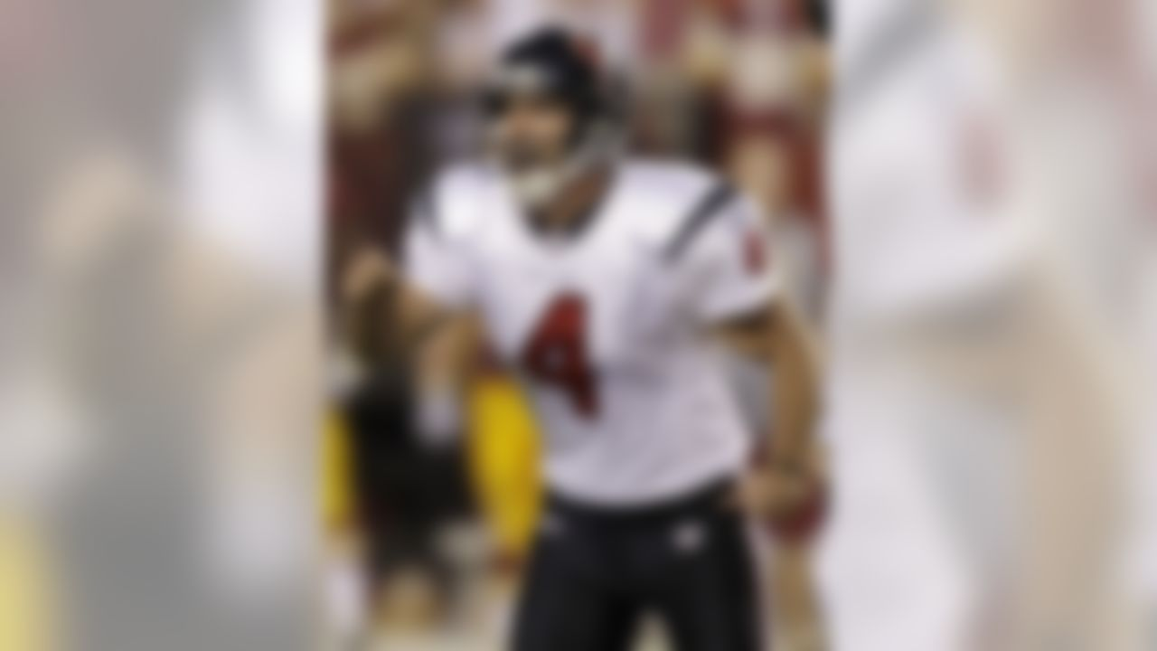 Houston Texans place kicker Neil Rackers (4) celebrates after kicking the game winning field goal in overtime of an NFL football game against the Washington Redskins, Sunday, Sept. 19, 2010, in Landover, Md. The Texans won 30-27. (AP Photo/Rob Carr)
