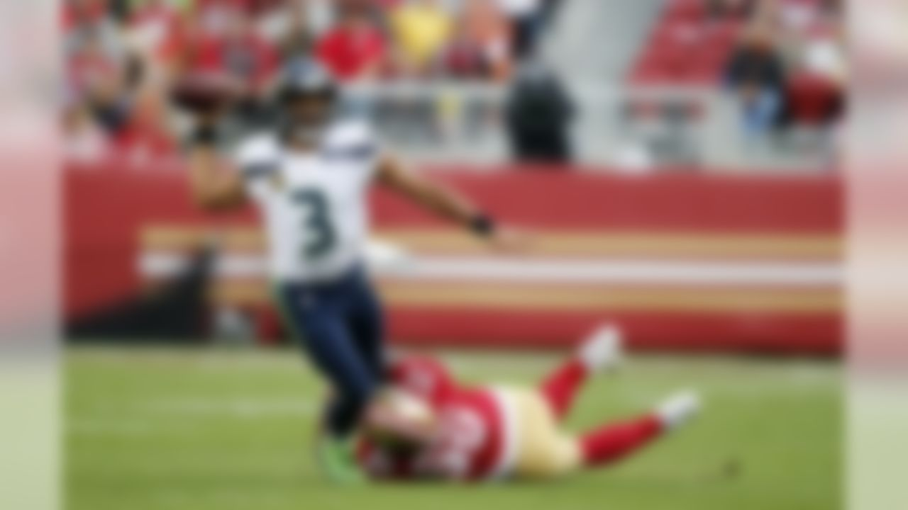Seattle Seahawks quarterback Russell Wilson (3) throws while being tackled by San Francisco 49ers defensive tackle DeForest Buckner (99) during the first half of an NFL football game Sunday, Nov. 26, 2017, in Santa Clara, Calif. (AP Photo/John Hefti)