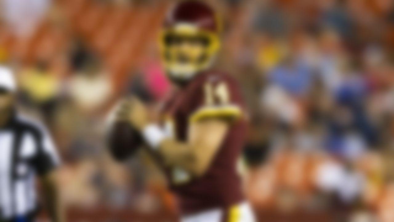 Washington Football Team quarterback Ryan Fitzpatrick (14) drops back to pass during an NFL preseason football game against the Cincinnati Bengals on Friday, Aug. 20, 2021 in Landover, MD.