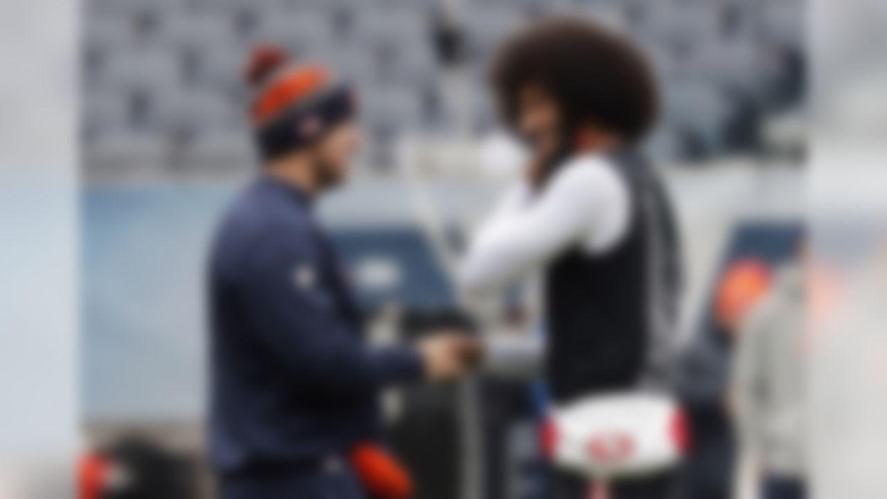 Chicago Bears quarterback Matt Barkley, left, and San Francisco 49ers quarterback Colin Kaepernick greet each other before an NFL football game, Sunday, Dec. 4, 2016, in Chicago. (AP Photo/Charles Rex Arbogast)