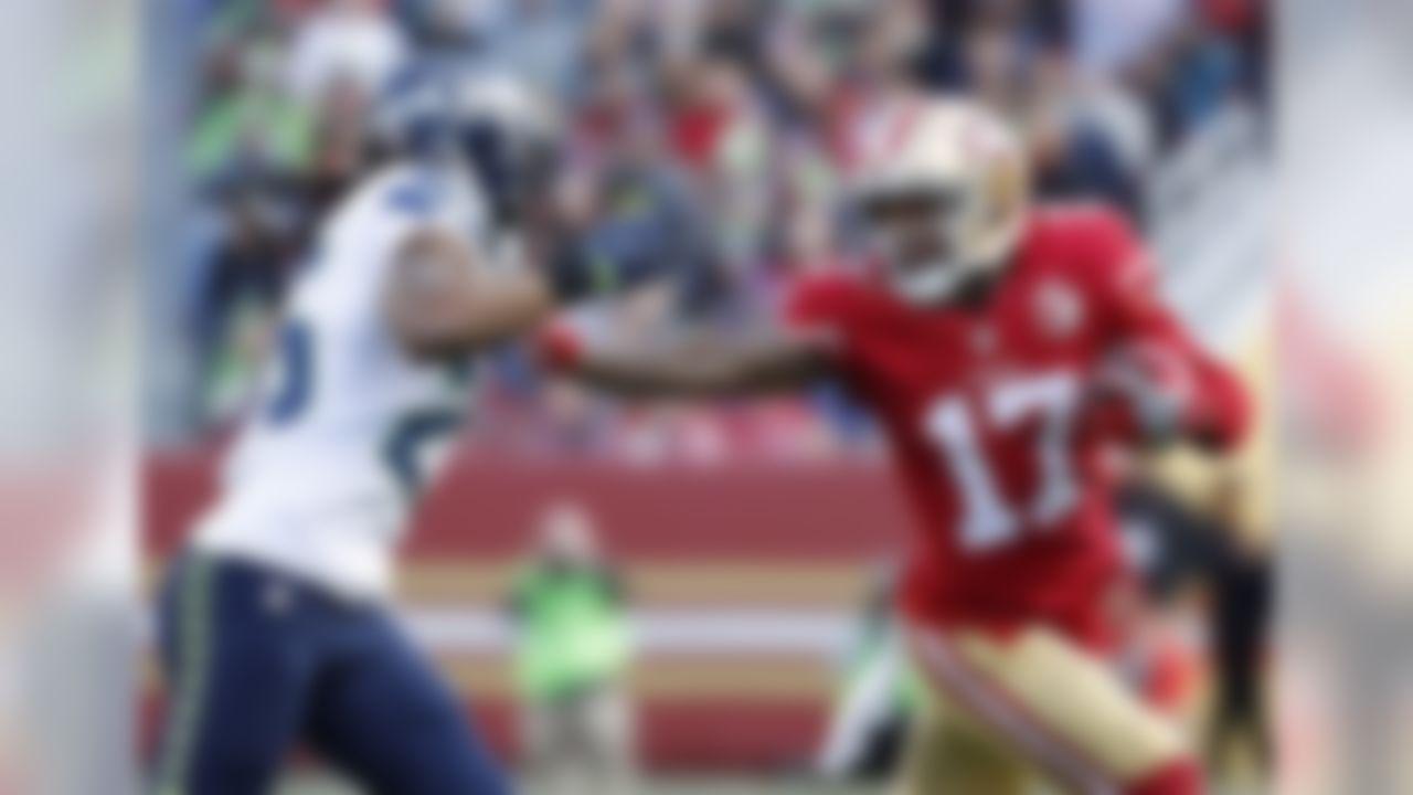 San Francisco 49ers wide receiver Jeremy Kerley (17) tries to stiff-arm Seattle Seahawks cornerback Richard Sherman during the first half of an NFL football game in Santa Clara, Calif., Sunday, Jan. 1, 2017. (AP Photo/Tony Avelar)