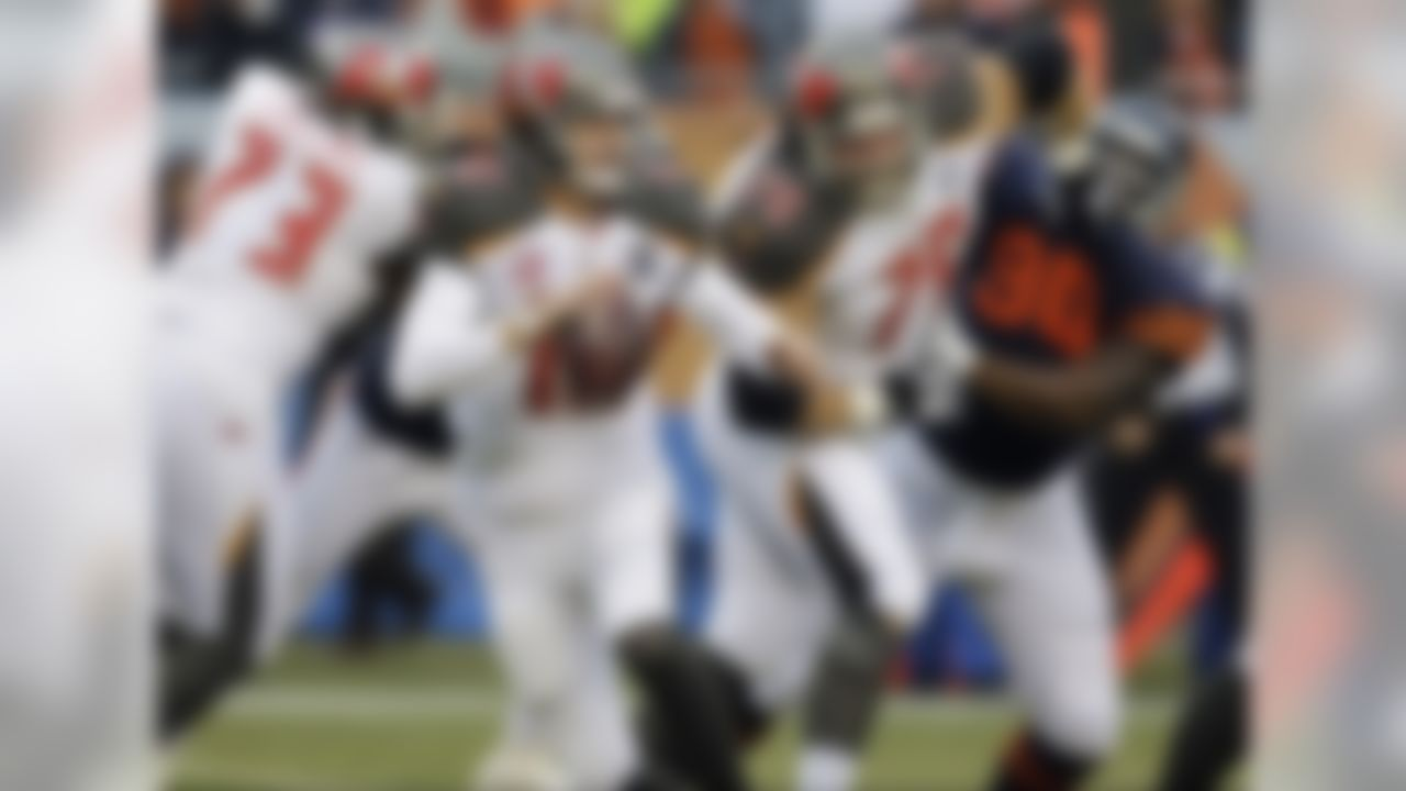 Tampa Bay Buccaneers quarterback Josh McCown (12) scrambles during the first half of an NFL football game against the Chicago Bears Sunday, Nov. 23, 2014, in Chicago. (AP Photo/Nam Y. Huh)