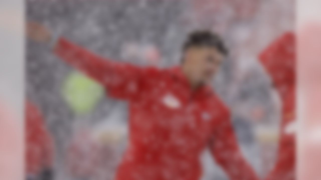 Kansas City Chiefs quarterback Patrick Mahomes (15) warms up in the snow before an NFL football game against the Denver Broncos in Kansas City, Mo., Sunday, Dec. 15, 2019. (AP Photo/Charlie Riedel)