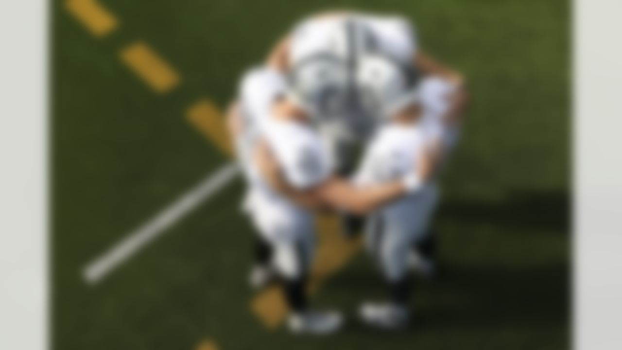 Las Vegas Raiders kicker Daniel Carlson (2), long snapper Trent Sieg (47) and punter A.J. Cole (6) huddle up prior to an NFL football game against the Los Angeles Chargers.
