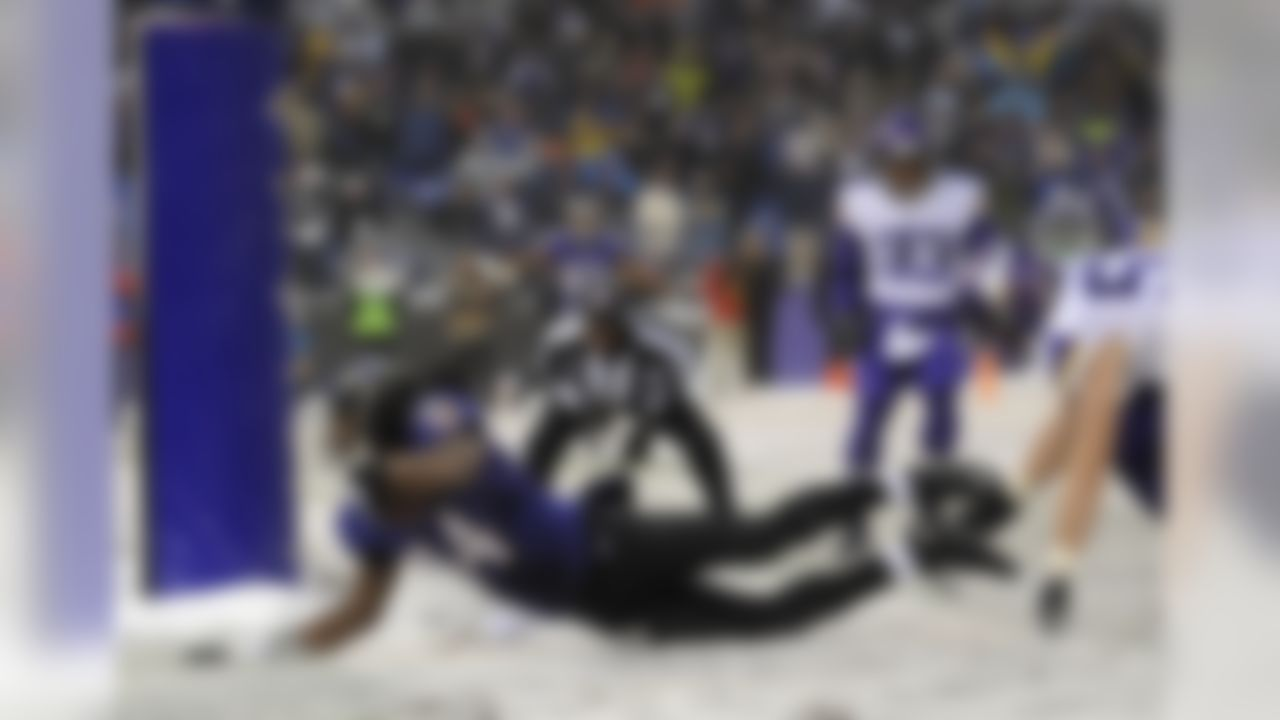 Baltimore Ravens wide receiver Marlon Brown (14) scores a touchdown in the second half of an NFL football game against the Minnesota Vikings, Sunday, Dec. 8, 2013, in Baltimore. Baltimore won 29-26. (AP Photo/Nick Wass)