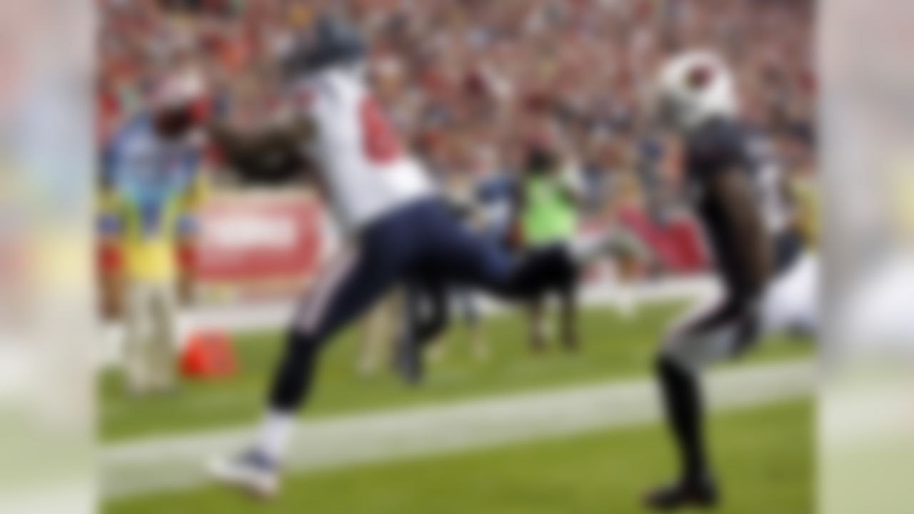 Houston Texans wide receiver Andre Johnson, left, makes a touchdown catch as Arizona Cardinals cornerback Patrick Peterson defends during the first half of an NFL football game Sunday, Nov. 10, 2013, in Glendale, Ariz. (AP Photo/Ross D. Franklin)