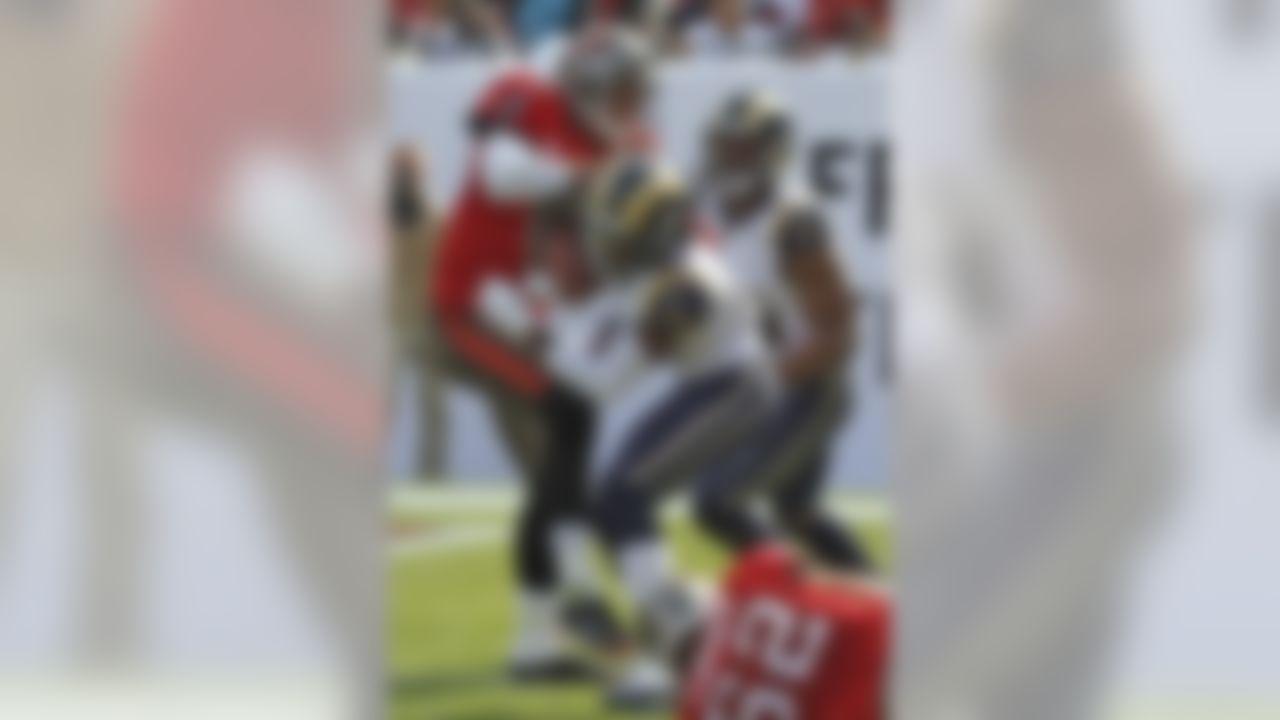 St. Louis Rams cornerback Janoris Jenkins (21) runs into Tampa Bay Buccaneers quarterback Josh Freeman (5) after intercepting Freeman's pass and returning it 41 yards for a touchdown during the second quarter of an NFL football game on Sunday, Dec. 23, 2012, in Tampa, Fla. Rams is Robert Quinn (94) blocks. (AP Photo/Reinhold Matay)