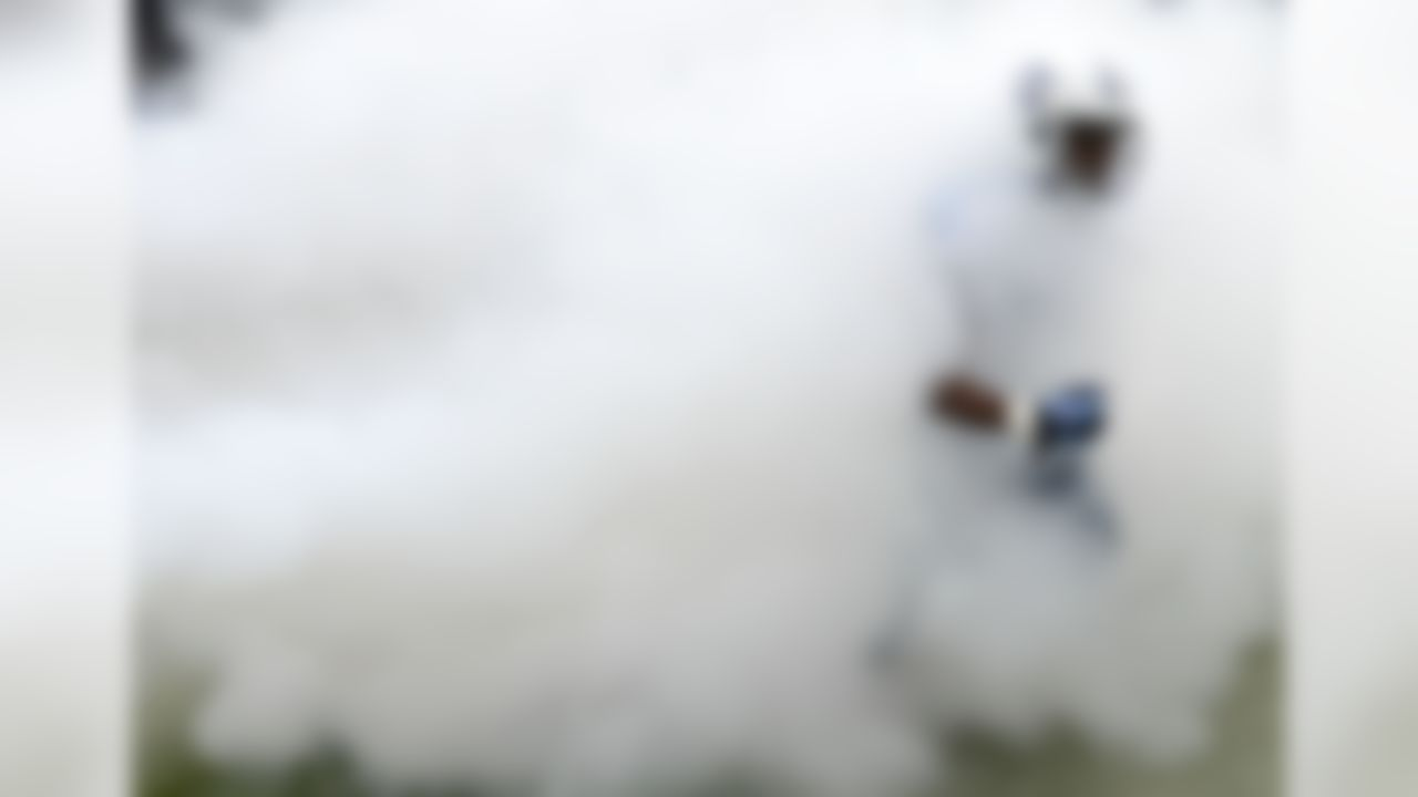 Tennessee Titans cornerback Blidi Wreh-Wilson runs through smoke as he is introduced before a game against the Jacksonville Jaguars. (AP Photo/Mark Zaleski)