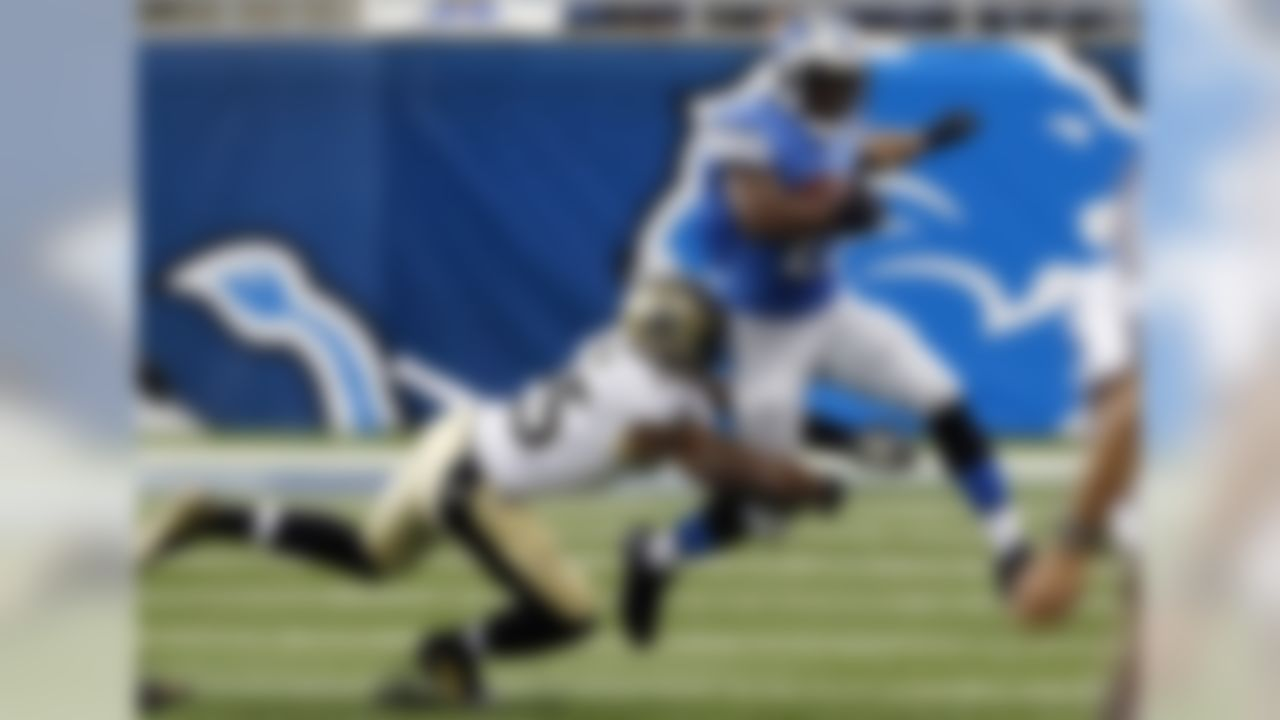 Detroit Lions running back Reggie Bush (21) is tackled by New Orleans Saints free safety Rafael Bush (25) during the first half of an NFL football game in Detroit, Sunday, Oct. 19, 2014. (AP Photo/Paul Sancya)