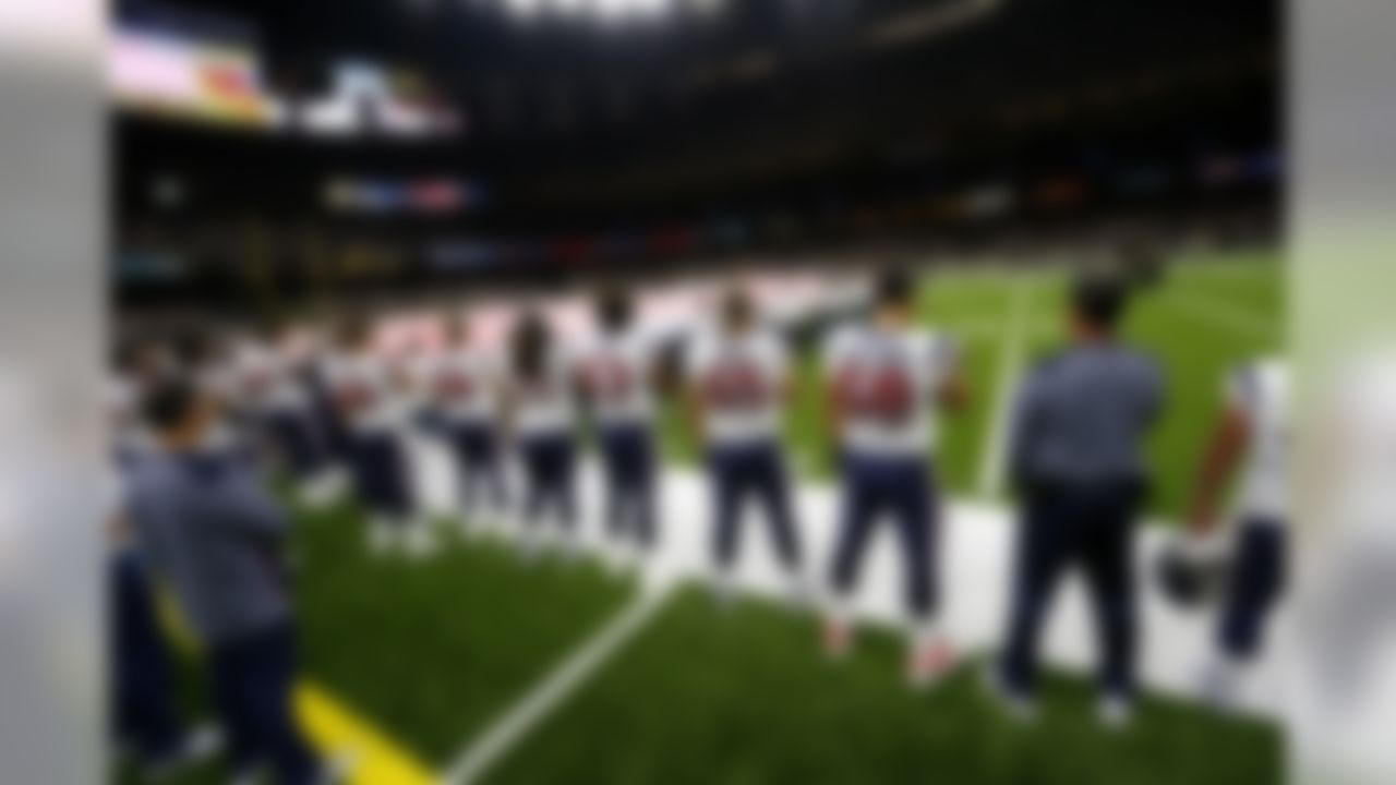 Houston Texans players stand at attention for the national anthem before the start of a preseason NFL football game against the New Orleans Saints in New Orleans, Saturday, Aug. 26, 2017. (AP Photo/Butch Dill)