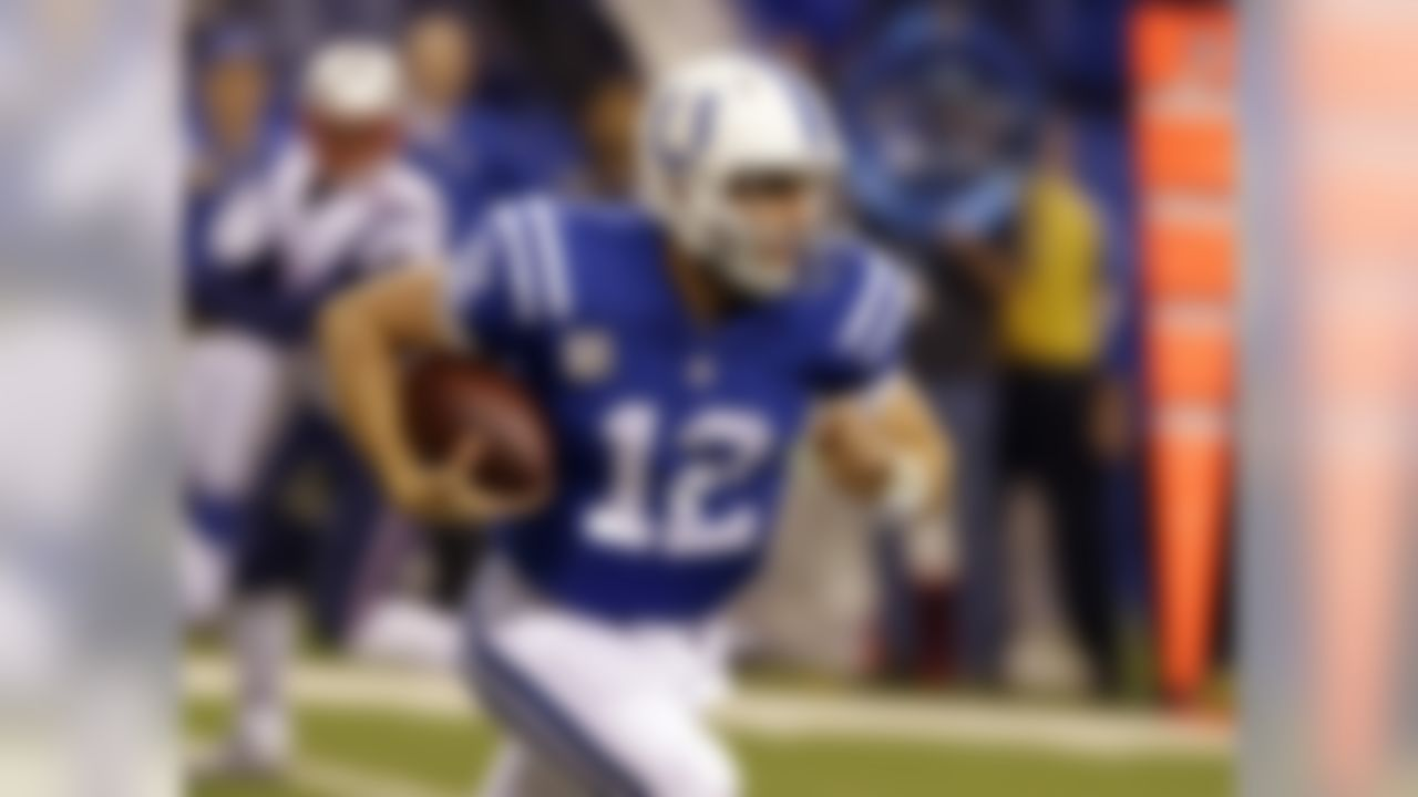 Indianapolis Colts quarterback Andrew Luck runs after being chased front he pocket by the New England Patriots during the first half of an NFL football game in Indianapolis, Sunday, Nov. 16, 2014. (AP Photo/Michael Conroy)