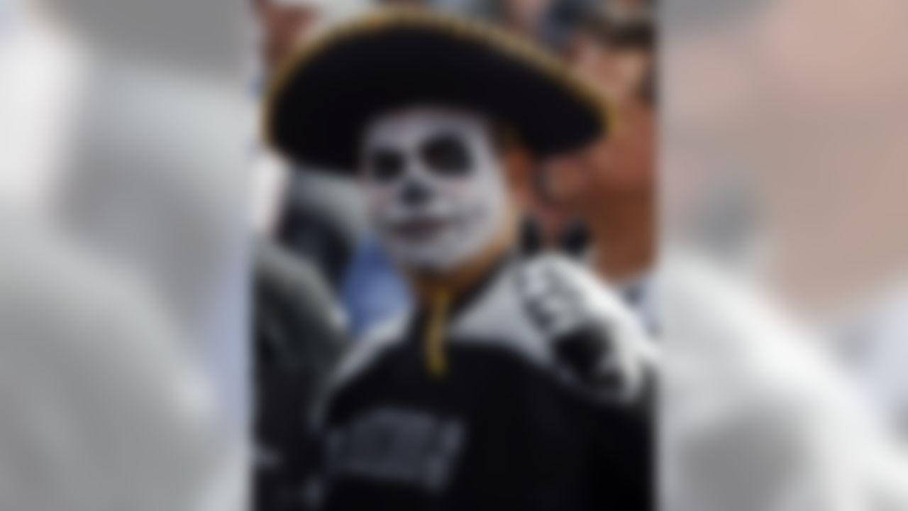 An Oakland Raiders fan gestures before an NFL football game against the New England Patriots, Sunday, Nov. 19, 2017, in Mexico City. (AP Photo/Eduardo Verdugo)