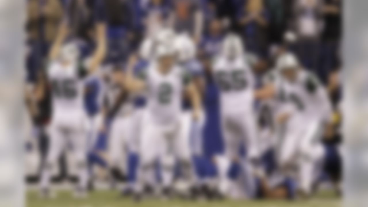 New York Jets place kicker Nick Folk (2) reacts after kicking the game winning 32-yard field goal during the fourth quarter of an NFL AFC wild card football playoff game against the Indianapolis Colts in Indianapolis, Saturday, Jan. 8, 2011. New York won 17-16.  (AP Photo/Nam Y. Huh)