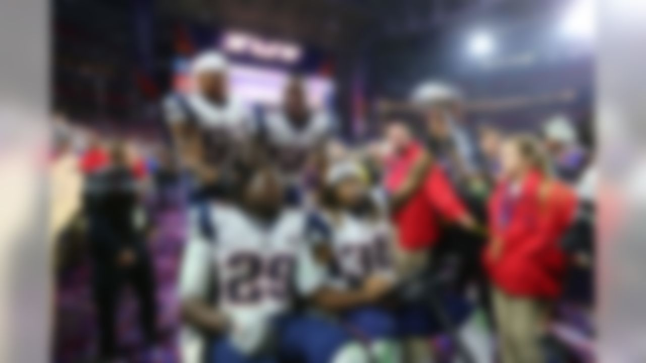 New England Patriots running backs LeGarrette Blount (29) and Brandon Bolden (38) and linebackers James Morris (52) and Darius Fleming (58) drive the Vince Lombardi Trophy around in a golf cart after defeating the Seattle Seahawks in Super Bowl XLIX at University of Phoenix Stadium on Sunday, February 1, 2015, in Glendale, AZ. (Steve Sanders/NFL)
