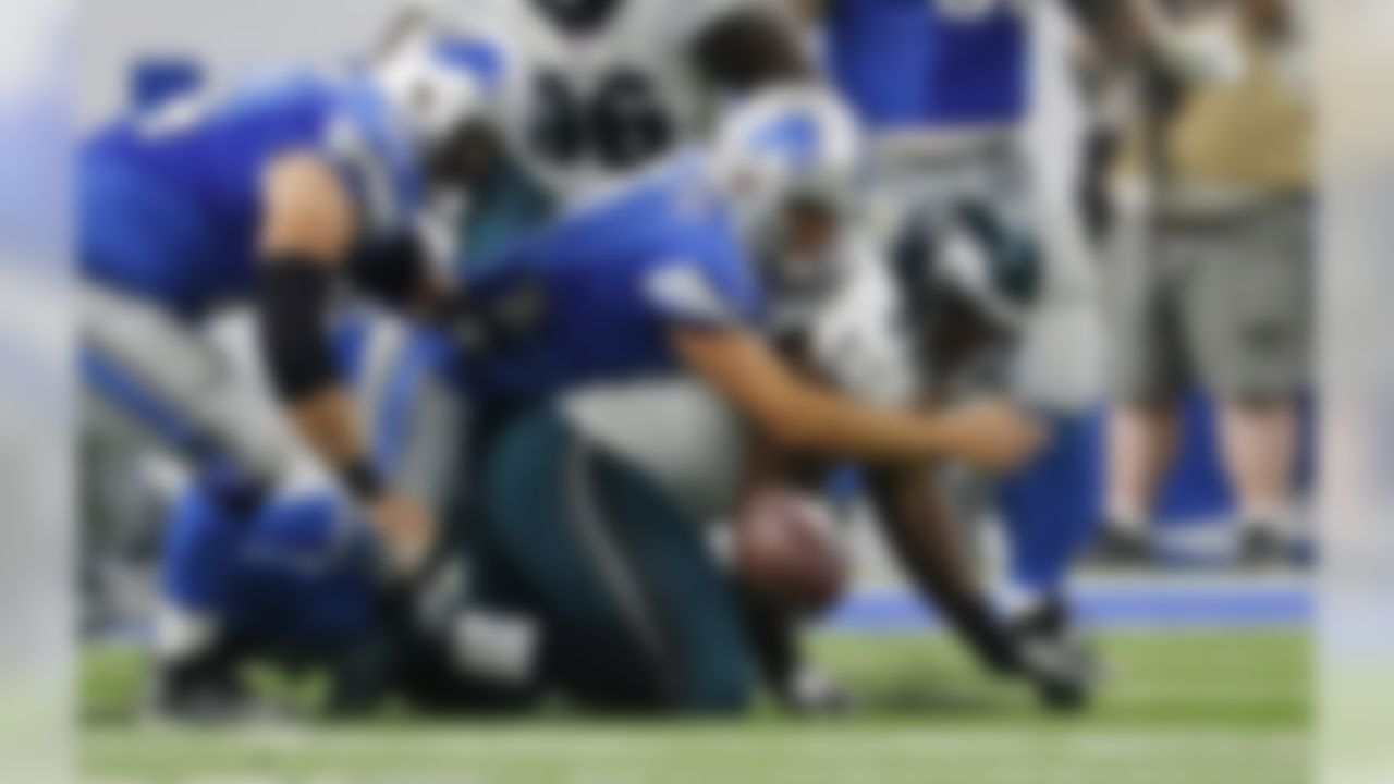 Philadelphia Eagles defensive tackle Fletcher Cox (91) tries recovering the fumble by Detroit Lions quarterback Matthew Stafford (9) during the second half of an NFL football game, Sunday, Oct. 9, 2016, in Detroit. (AP Photo/Rick Osentoski)