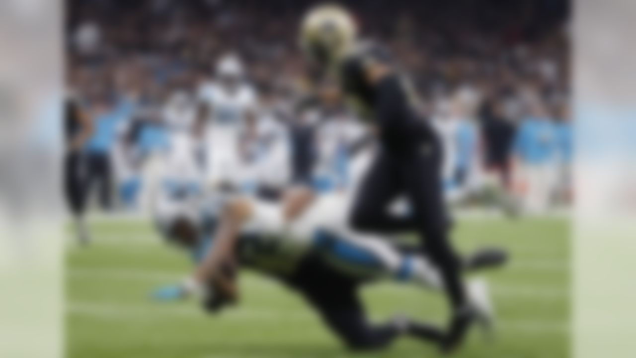 Carolina Panthers wide receiver D.J. Moore (12) is brought down at the one yard line by New Orleans Saints free safety Marcus Williams as cornerback Marshon Lattimore (23) covers, in the first half of an NFL football game in New Orleans, Sunday, Dec. 30, 2018. (AP Photo/Gerald Herbert)