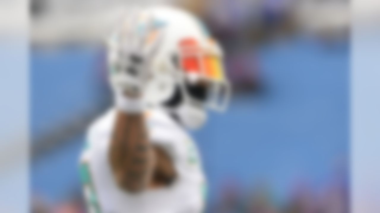 Miami Dolphins wide receiver Kenny Stills (10) gestures before an NFL football game against the Buffalo Bills Sunday, December 17, 2017, in Orchard Park, N.Y. (AP Photo/Adrian Kraus)