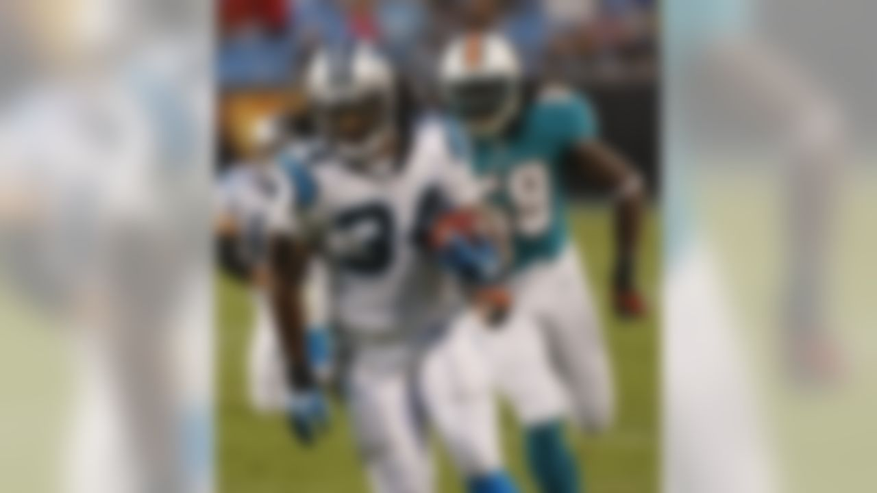 Carolina Panthers' DeAngelo Williams (34) runs past Miami Dolphins' Gary Guyton (59) during the first quarter of a preseason NFL football game in Charlotte, N.C., Friday, Aug. 17, 2012. (AP Photo/Nell Redmond)