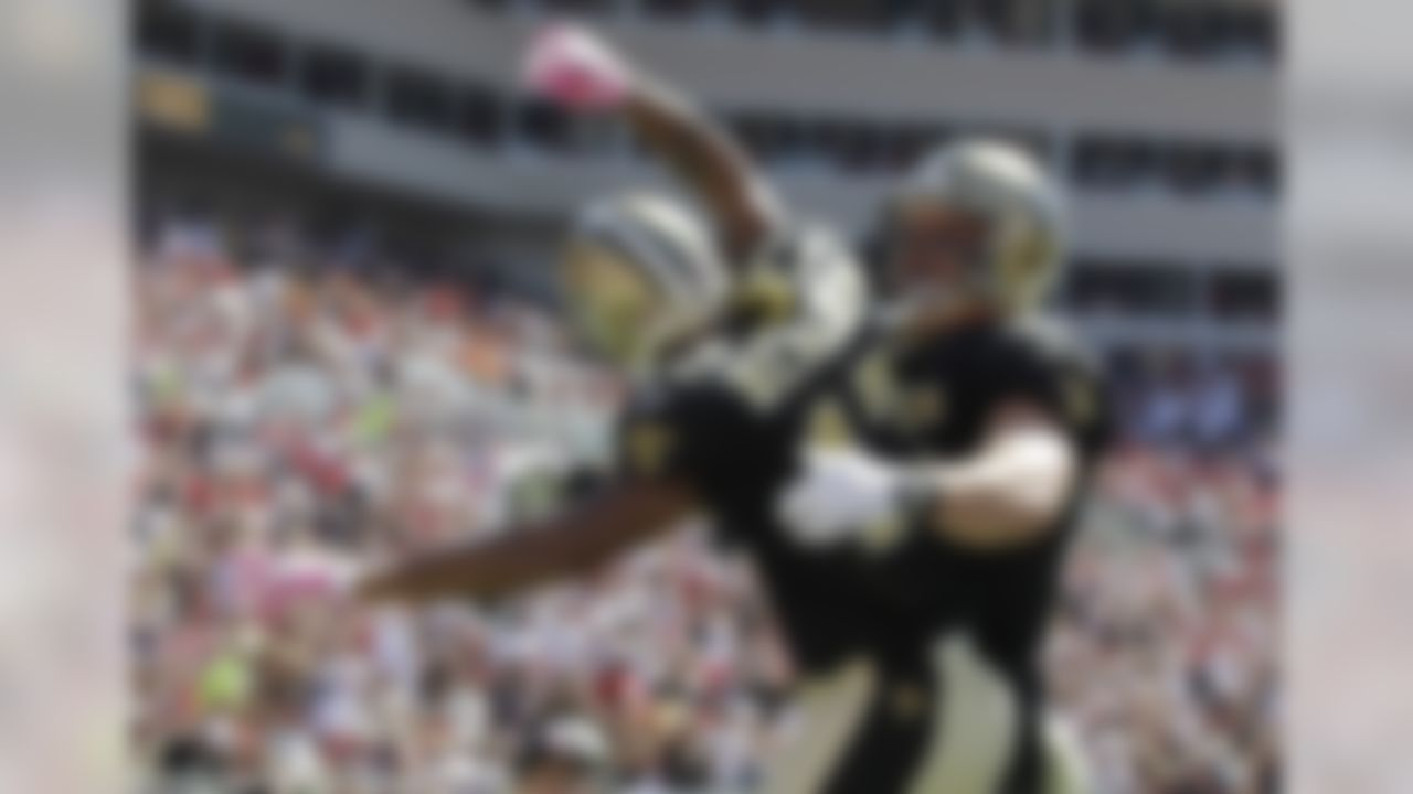 New Orleans Saints receiver Robert Meachem (17) reacts with teammate David Thomas following a first half score against the Tampa Bay Buccaneers in their NFL football game in Tampa, Fla., Sunday, Oct. 17, 2010.  (AP Photo/Chris O'Meara)