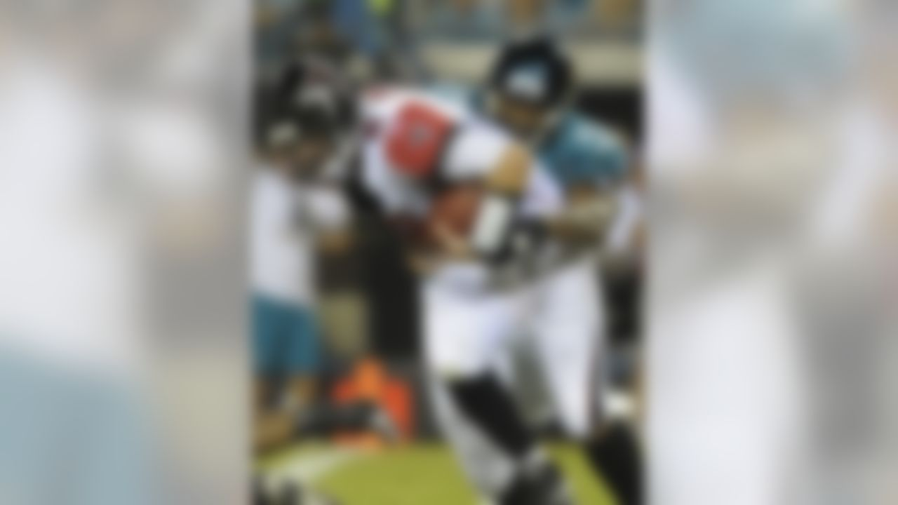 Atlanta Falcons quarterback Chris Redman (8), left, is sacked by Jacksonville Jaguars defensive end Larry Hart (59) during the first half of a preseason NFL football game in Jacksonville, Fla., Thursday, Sept. 2, 2010.(AP Photo/Phelan M. Ebenhack)