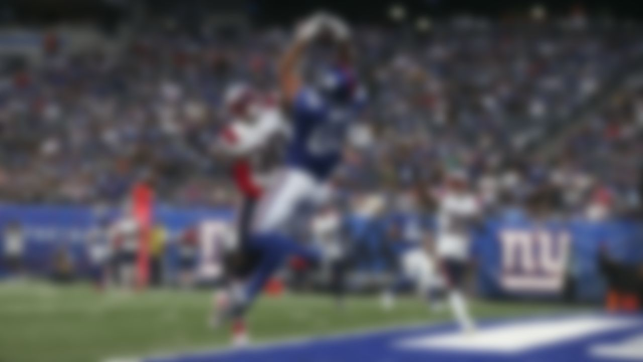 New York Giants tight end Kaden Smith (82) makes a touchdown catch over New England Patriots free safety Adrian Colbert (30) during an NFL preseason football game, Sunday, Aug. 29, 2021 in East Rutherford, N.J.