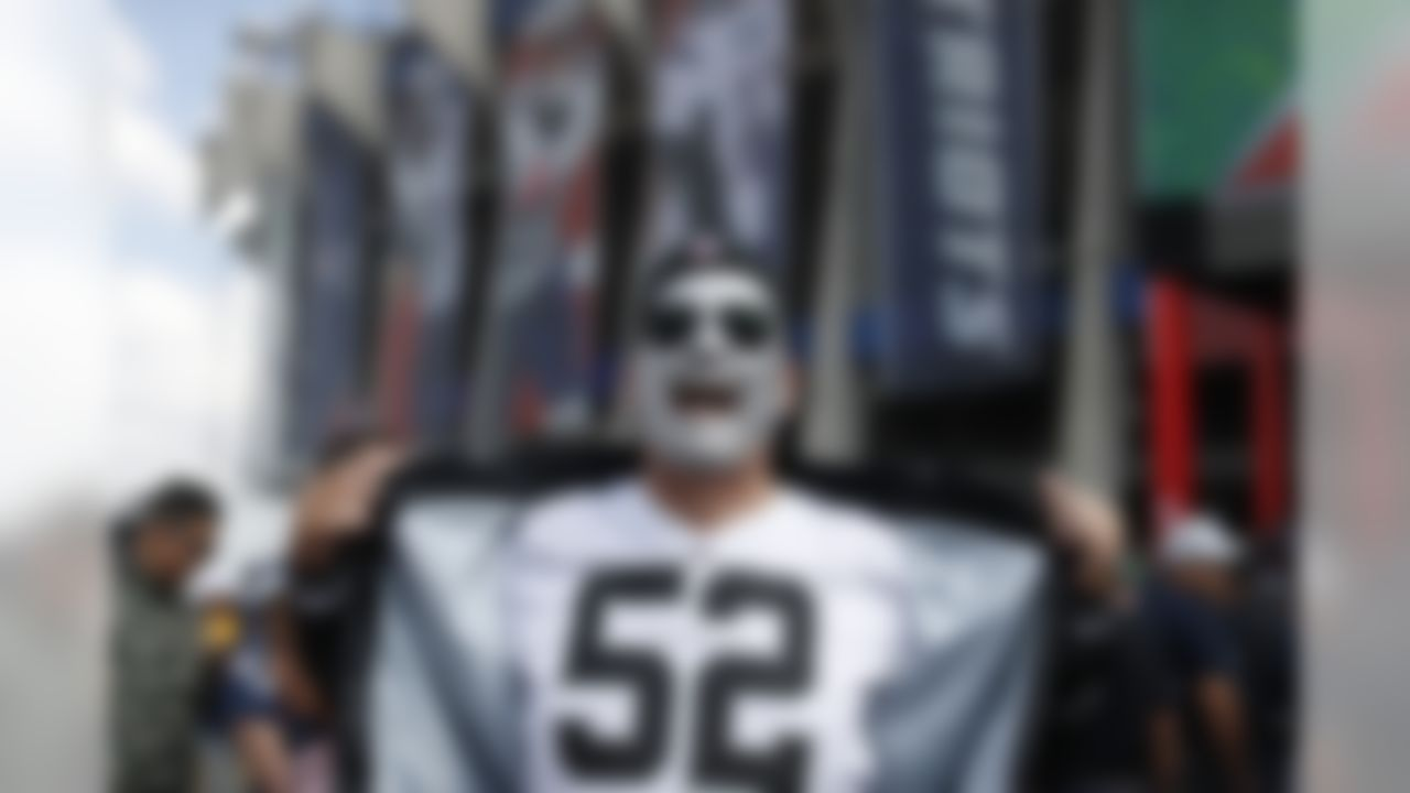 An Oakland Raiders fan poses for a photo in front of Azteca Stadium prior to an NFL fotball game against the New England Patriots, Sunday, Nov. 19, 2017, in Mexico City. (AP Photo/Dario Lopez-Mills)