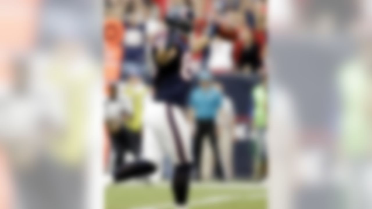Houston Texans' James Casey celebrates scoring a touchdown Tennessee Titans in the first quarter of an NFL football game Sunday, Sept. 30, 2012, in Houston. (AP Photo/Eric Gay)