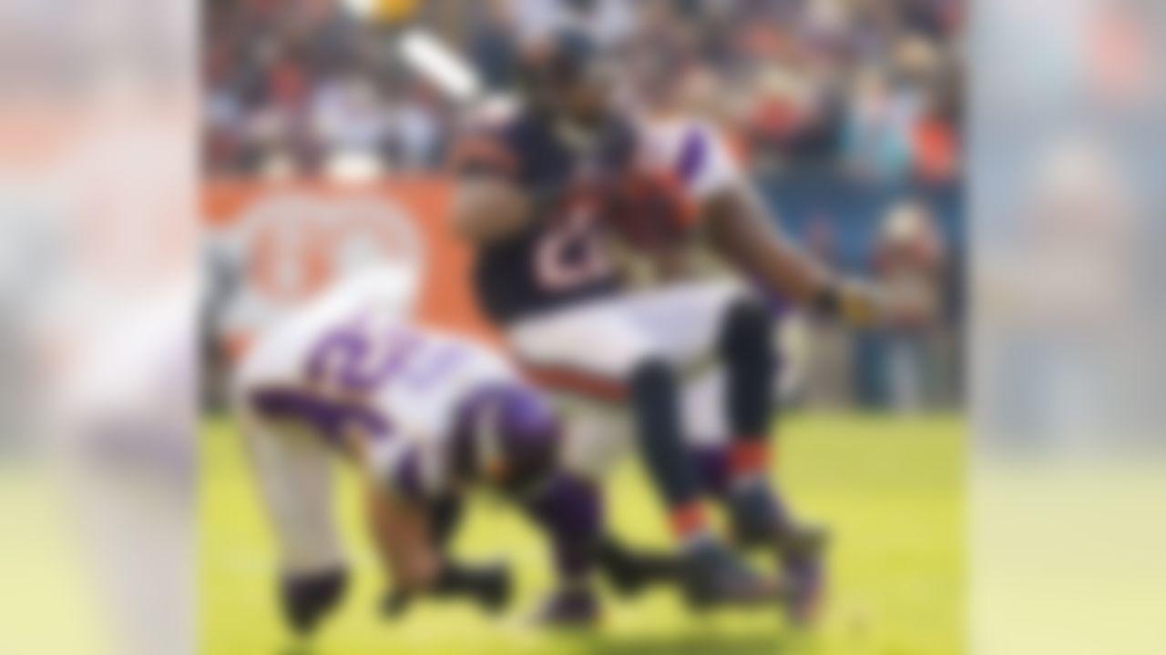 Running back Matt Forte #22 of the Chicago Bears gets spun around by cornerback A.J. Jefferson #24 linebacker Jasper Brinkley #54 of the Minnesota Vikings during week twelve action between the Minnesota Vikings and Chicago Bears at Soldier Field in Chicago, IL on Nov. 25, 2012 (Todd Rosenberg/NFL)