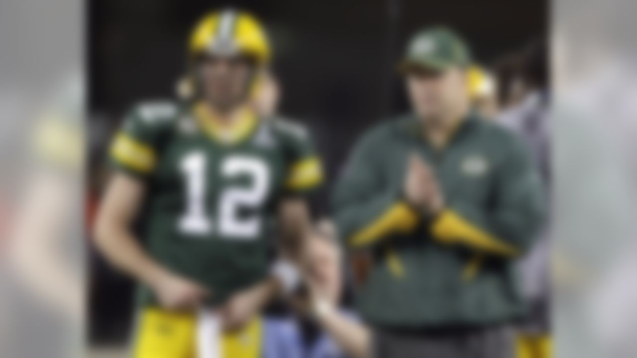 Green Bay Packers' Aaron Rodgers talks with head coach Mike McCarthy before the NFL Super Bowl XLV football game against the Pittsburgh Steelers at The Cowboys Stadium in Arlington, TX on February 6, 2011. (AP Photo/Paul Sancya)